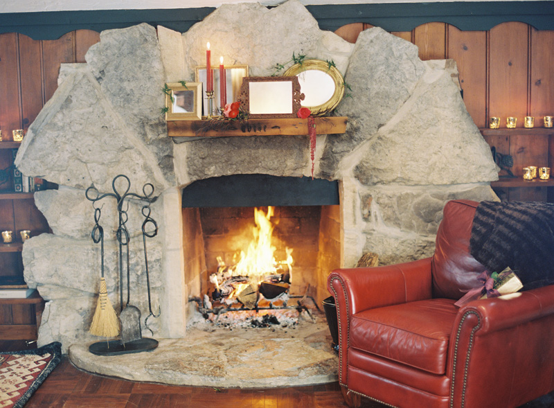 Fire Place and Red Leather Chair | Northern Michigan Winter Wedding | Tableau Events