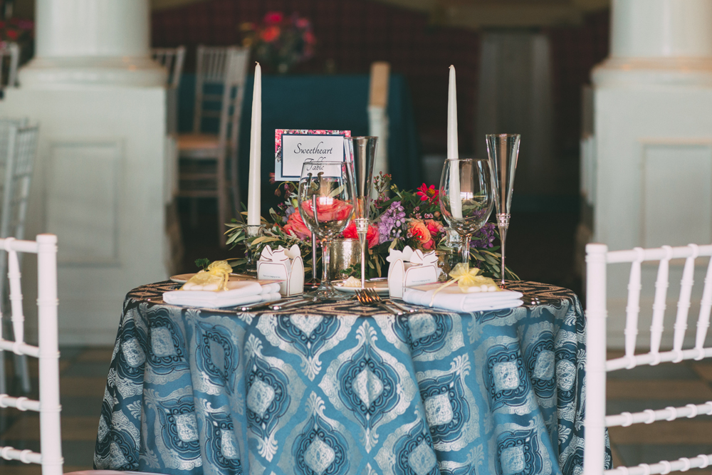 Sweetheart Table Arrangement | Blue Patterned Table Cloth | Tableau Events